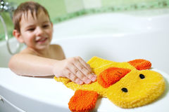The boy in the bathroom. With a great mood and yellow sponge Royalty Free Stock Photography