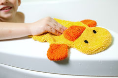 The boy in the bathroom. With a great mood and yellow sponge Stock Images