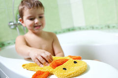 The boy in the bathroom. With a great mood and yellow sponge Royalty Free Stock Photo