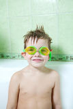 The boy in the bathroom. A boy with glasses for swimming, in the bathroom, with excellent mood Stock Image