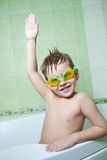 The boy in the bathroom. A boy with glasses for swimming, in the bathroom, with excellent mood Stock Photo