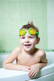 The boy in the bathroom. A boy with glasses for swimming, in the bathroom, with excellent mood Royalty Free Stock Images