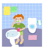 Boy in the bathroom Stock Images