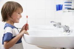 Boy In Bathroom Brushing Teeth Royalty Free Stock Images