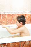 Boy in bathtube Royalty Free Stock Image
