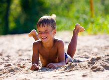 Boy on the beach Stock Photography