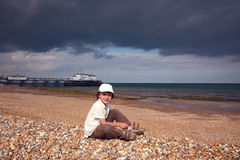 Boy at the beach. Boy leaving the beach as the weather changing Stock Images