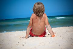 Boy on beach Stock Photo