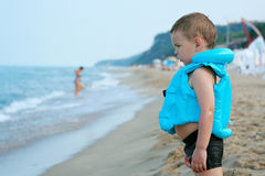 The boy on the beach. In anticipation of the surf Royalty Free Stock Images
