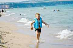The boy on the beach. In anticipation of the surf Royalty Free Stock Photography