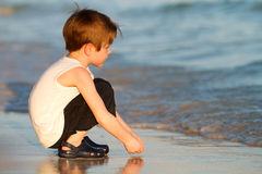 Boy at beach Stock Photography