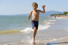 Boy on beach Royalty Free Stock Photography