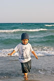 Boy on the beach Stock Photos