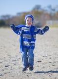Boy at beach Stock Photos