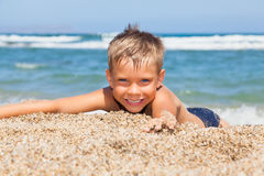 Boy on the beach. Playful boy on the beach Royalty Free Stock Image