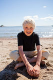 Boy on the beach Stock Image