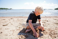Boy on the beach Royalty Free Stock Photos