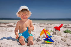 Boy is in the beach. Royalty Free Stock Image