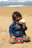 A boy at the beach. Drinking milk royalty free stock image