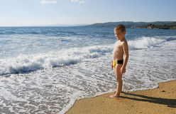 Boy on a beach Royalty Free Stock Photo