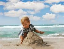 Boy on beach Stock Photos