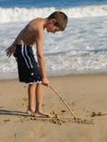 Boy on the beach Stock Photography