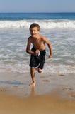 Boy on the beach. The boy runs on the beach Stock Photos