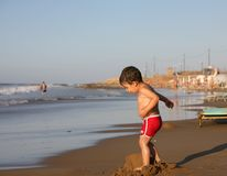 Boy at the beach Stock Photos