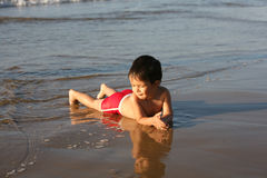 Boy at the beach. Boy playing at the beach royalty free stock image