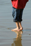 Boy on Beach. Boy walking barefoot on the beach Stock Photography