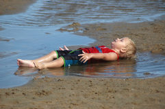 Boy on the beach. Boy playing in the water on the beach Royalty Free Stock Image