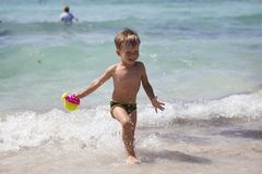Boy on the beach in Ayia Napa royalty free stock photography