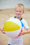 Boy with beach ball in summer Royalty Free Stock Photo