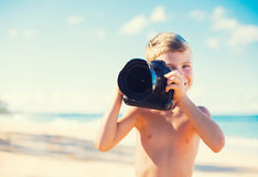 Boy on the Beach with Camera Royalty Free Stock Image