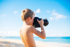 Boy on the Beach with Camera Royalty Free Stock Photos