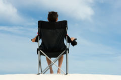 Boy in beach chair Stock Photography