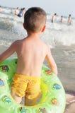 Boy beach. Chinese boy stand on beach watching with swim ring Stock Image