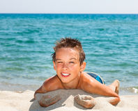Boy on a beach Royalty Free Stock Image