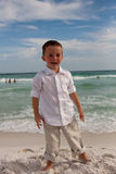 Boy on the beach having fun Royalty Free Stock Photos