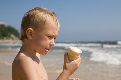 Boy. beach. ice cream Stock Photos