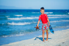 Boy on the beach Stock Images