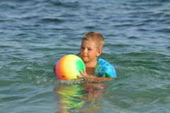 Boy on the beach playing with ball. Sumer sport Stock Photo