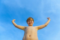 Boy at beach rises up his arms Royalty Free Stock Photos