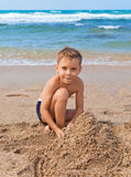 Boy on the beach with sand Royalty Free Stock Photos