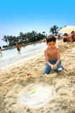Boy in beach sand Stock Photography