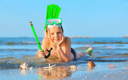 Boy on beach with snorkles Stock Images