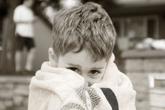 Boy in beach towel Stock Photo