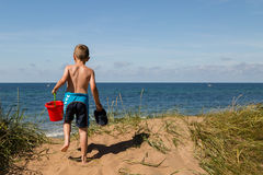 Boy with beach toys Stock Photo