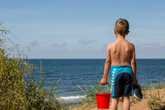 Boy with beach toys Royalty Free Stock Photo