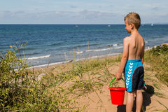 Boy with beach toys Stock Images
